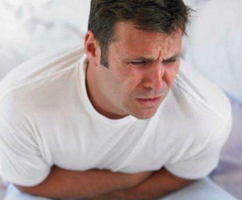 Боль в животе слева: причины и лечение